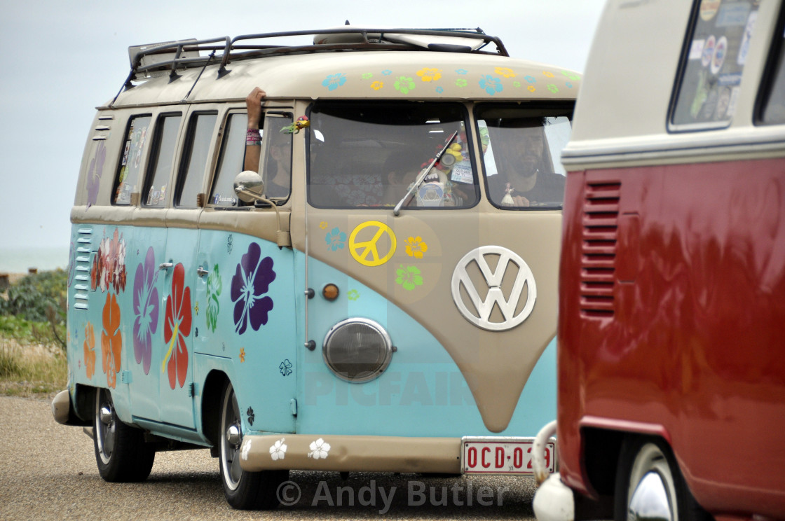 """""""VW Camper Van with Flowers painted on it."""" stock image"""