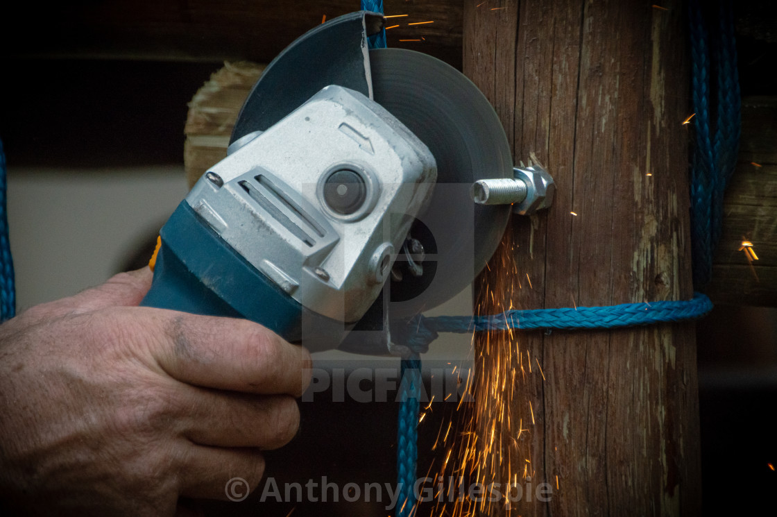 """Grinder in Man's Hand with Sparks"" stock image"