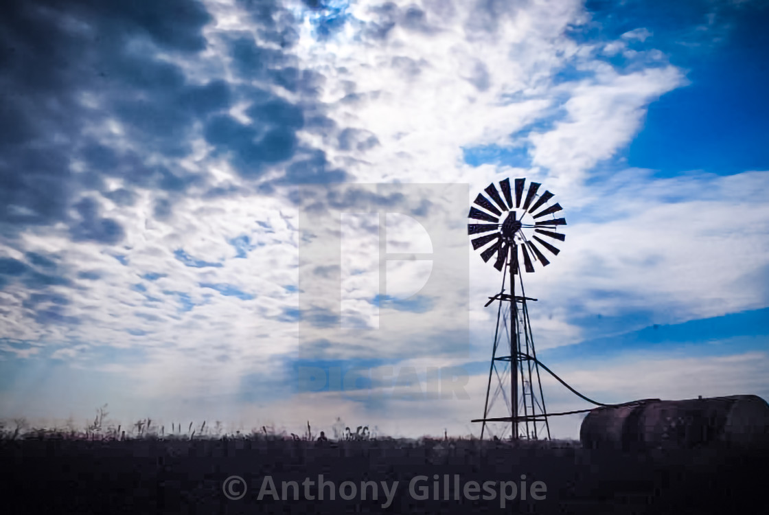 """""""The Silhouette of a Windmill"""" stock image"""