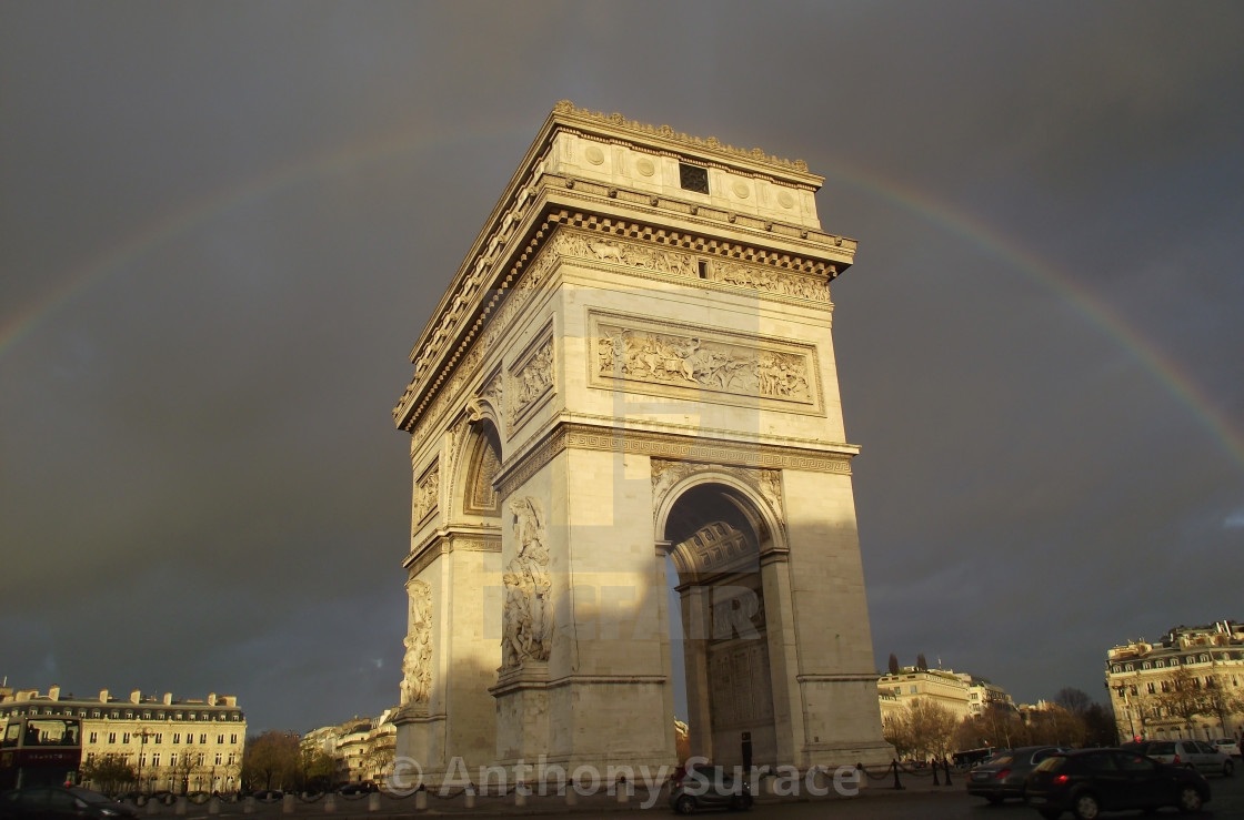 """Rainbow over Arc de Triomphe"" stock image"