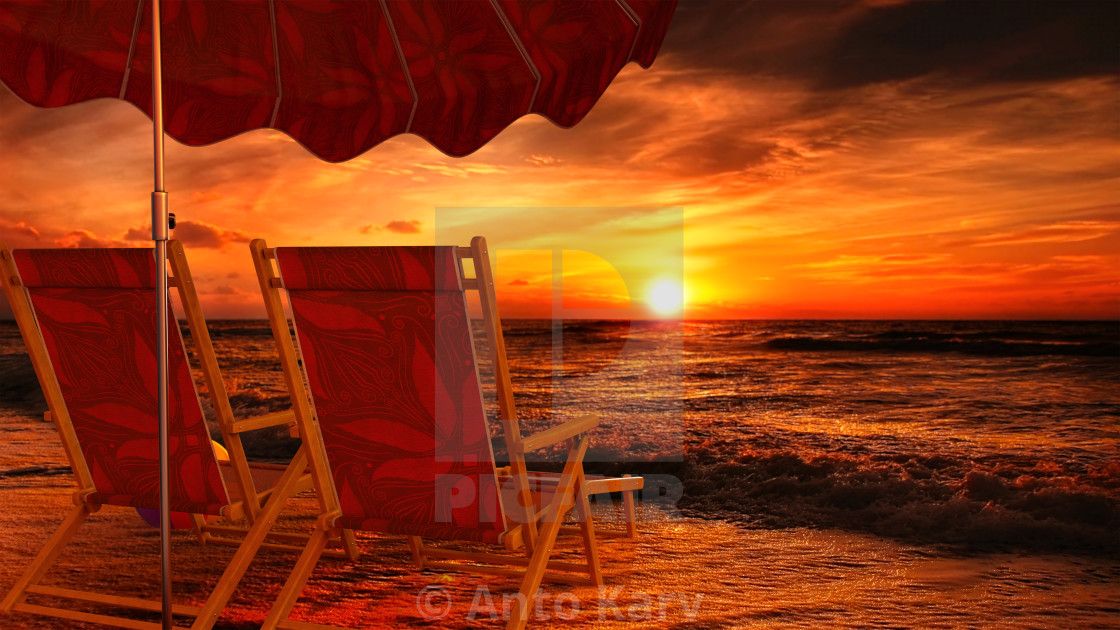 """""""Two empty chairs on beach under opened umbrella with view on sea sunset"""" stock image"""