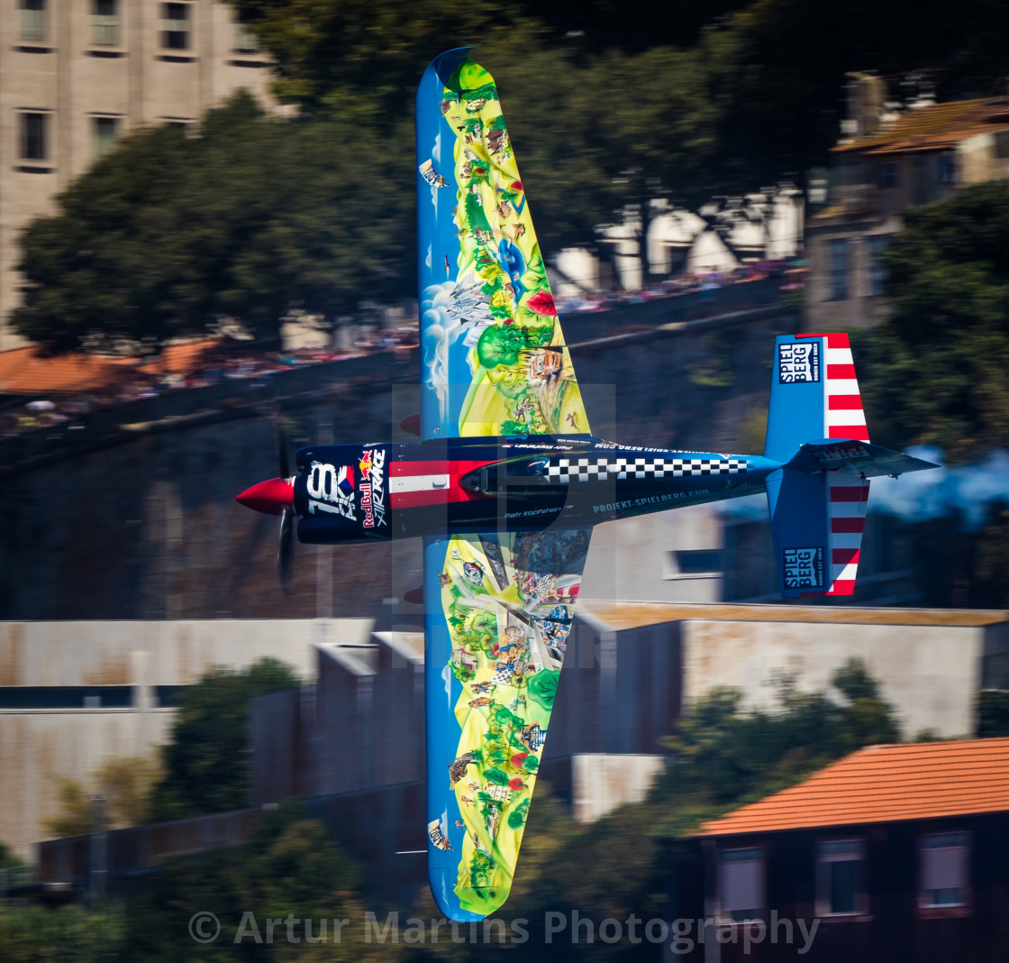 """Aerobatics aircraft flying low at high speed"" stock image"