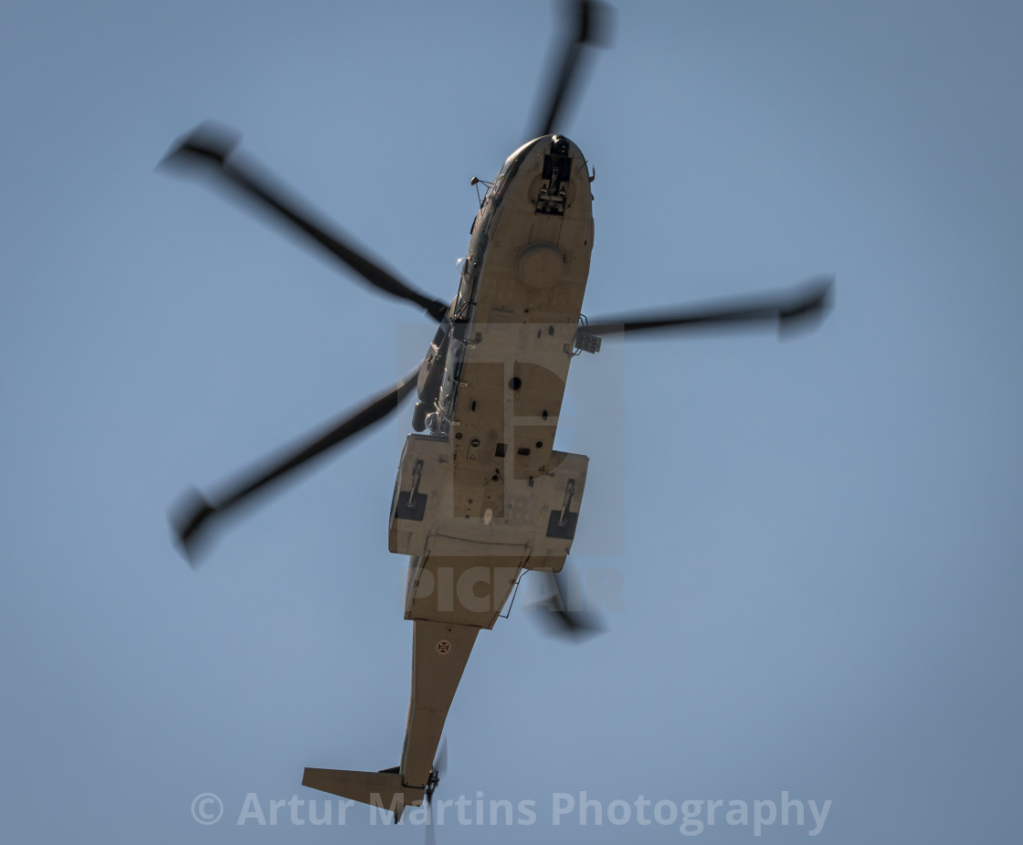 """Military helicopter overflying"" stock image"