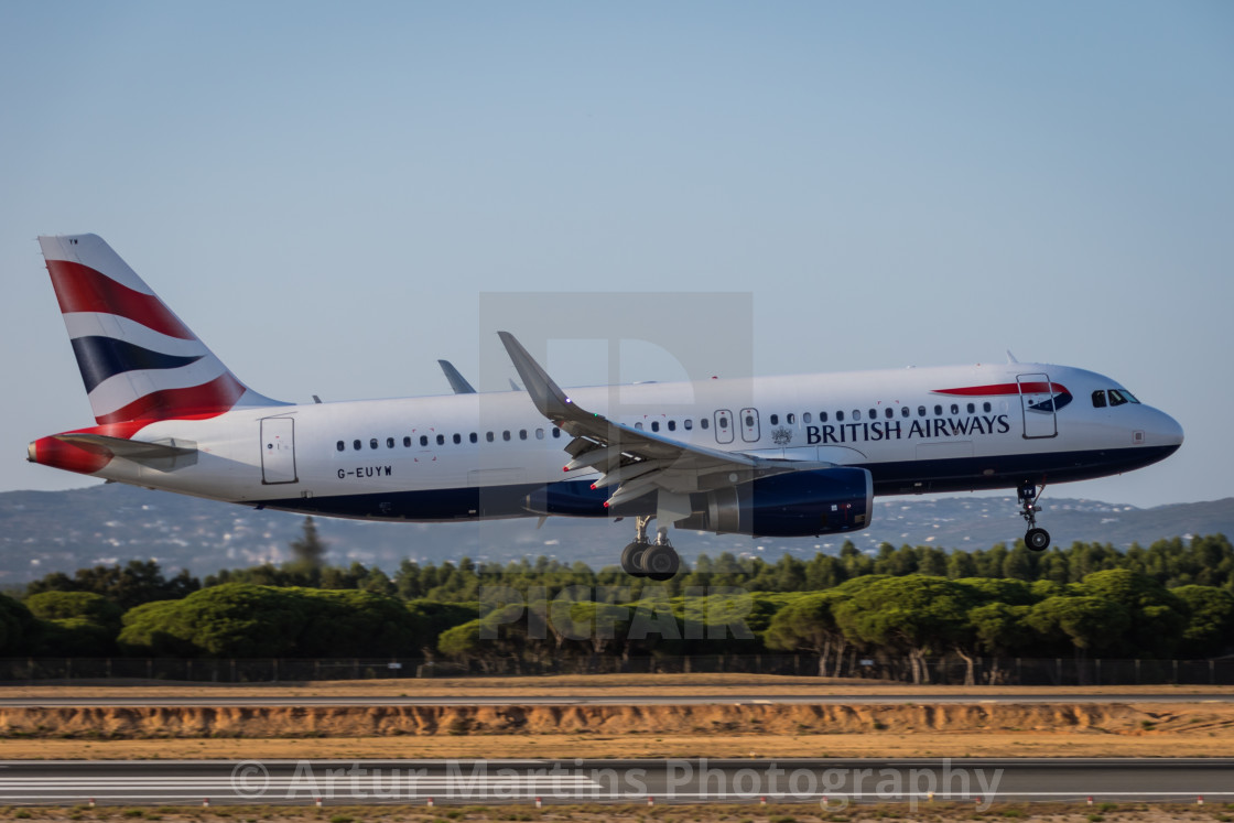 """Airliner Airbus A320 G-EUYW of British Airways landing at Faro Airport"" stock image"