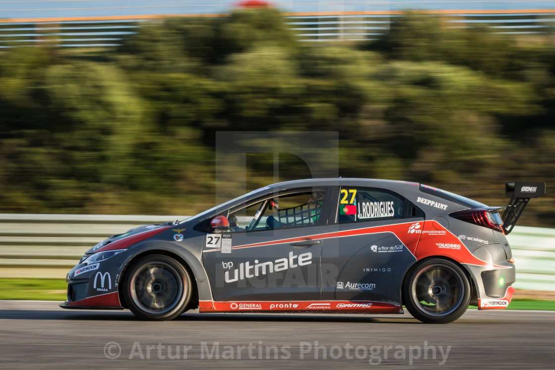 """A Honda Civic race car speeding along at Estoril Racetrack"" stock image"