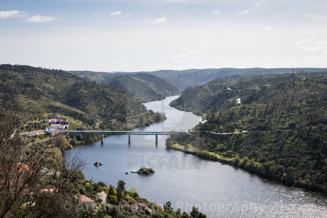 """The Tagus River winds along the hillsides at Belver"" stock image"