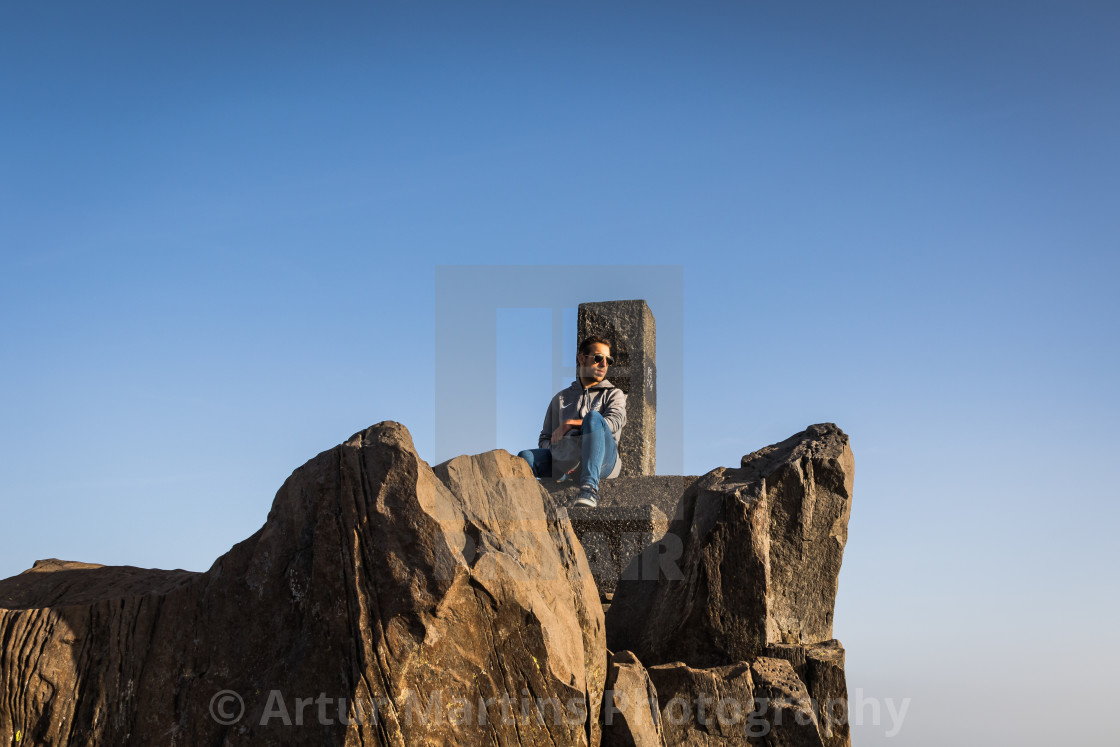 """Teenager boy enjoying the warm sun rays at Pico do Arieiro"" stock image"