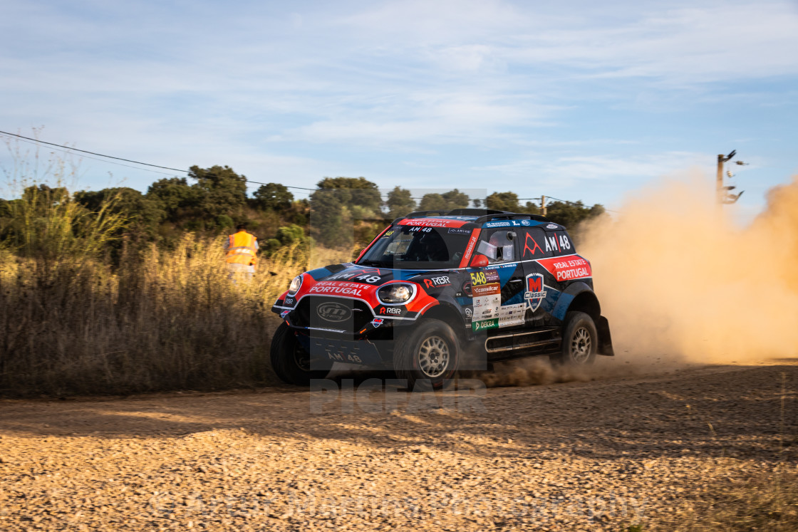 """A Mini John Cooper Works Rally off-road race car creates a cloud of dust"" stock image"
