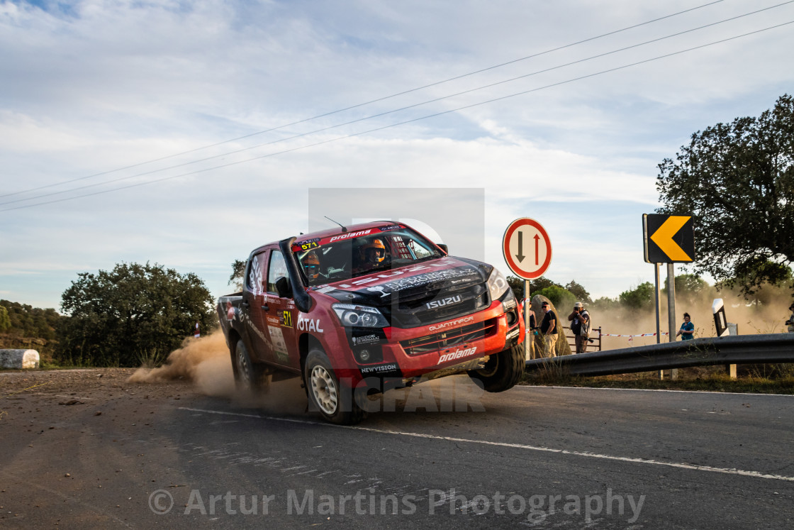 """An Isuzu D-Max off-road race car creates a cloud of dust"" stock image"