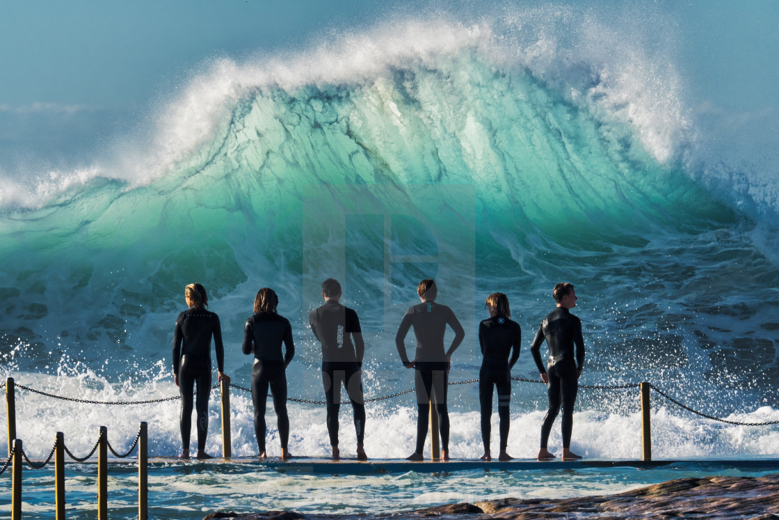 """""""Kids looking nonchalant in the face of a huge oncoming wave"""" stock image"""