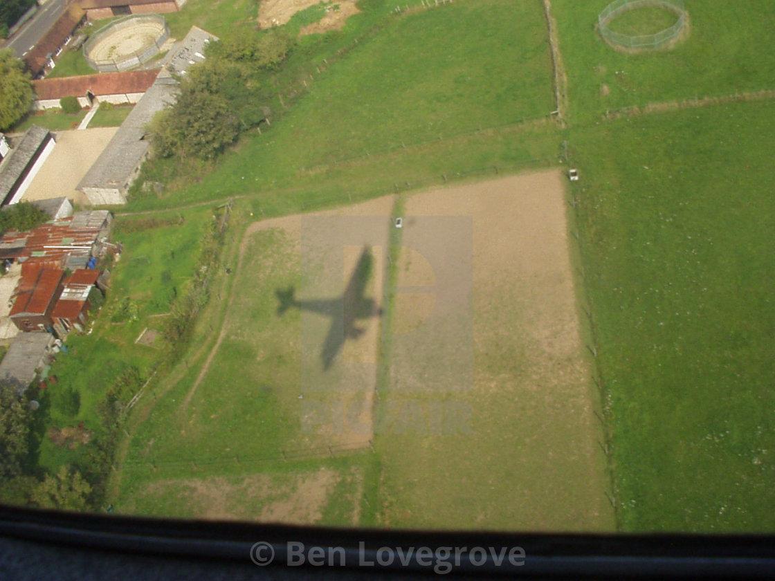 """Shadow of the de Havilland Rapide"" stock image"