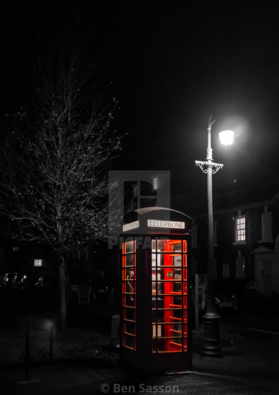 """Telephone box at night, UK"" stock image"