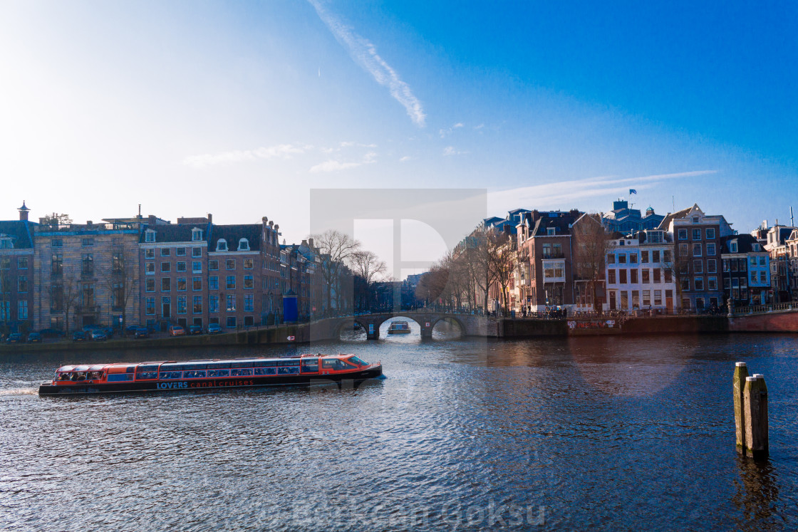 """Amsterdam canals and canal ship"" stock image"