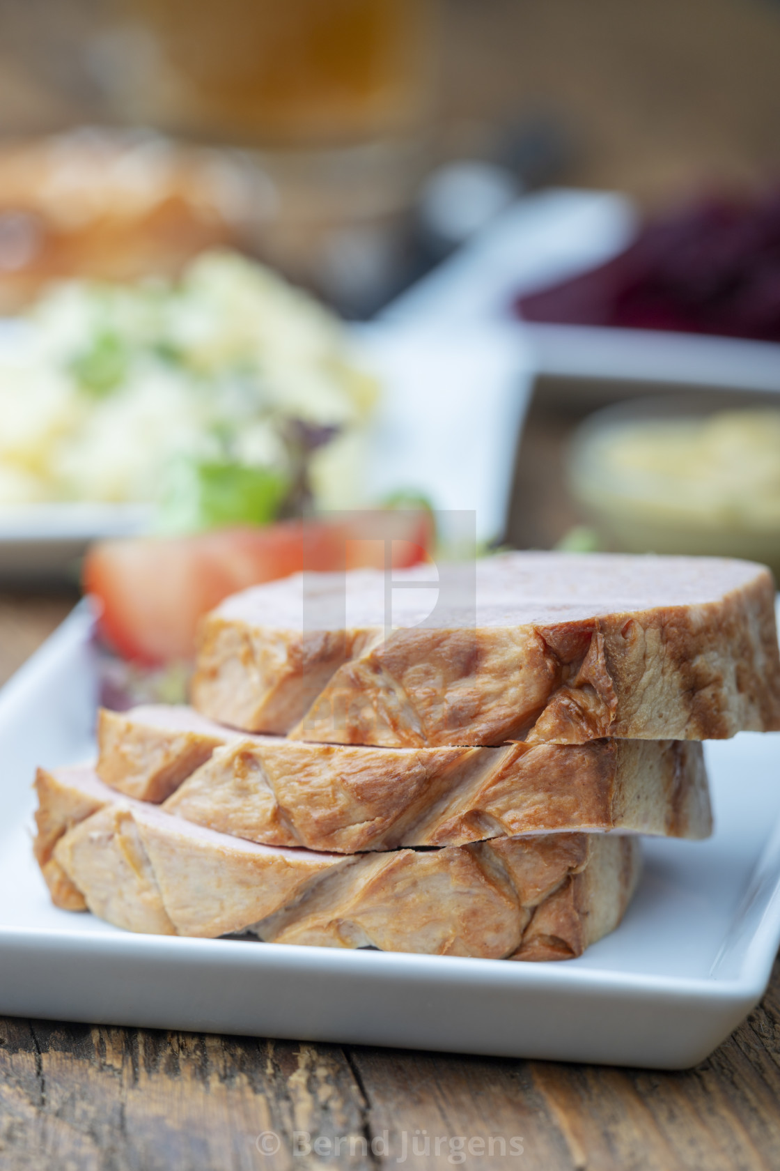 """closeup of a bavarian leberkaese on dark wood"" stock image"