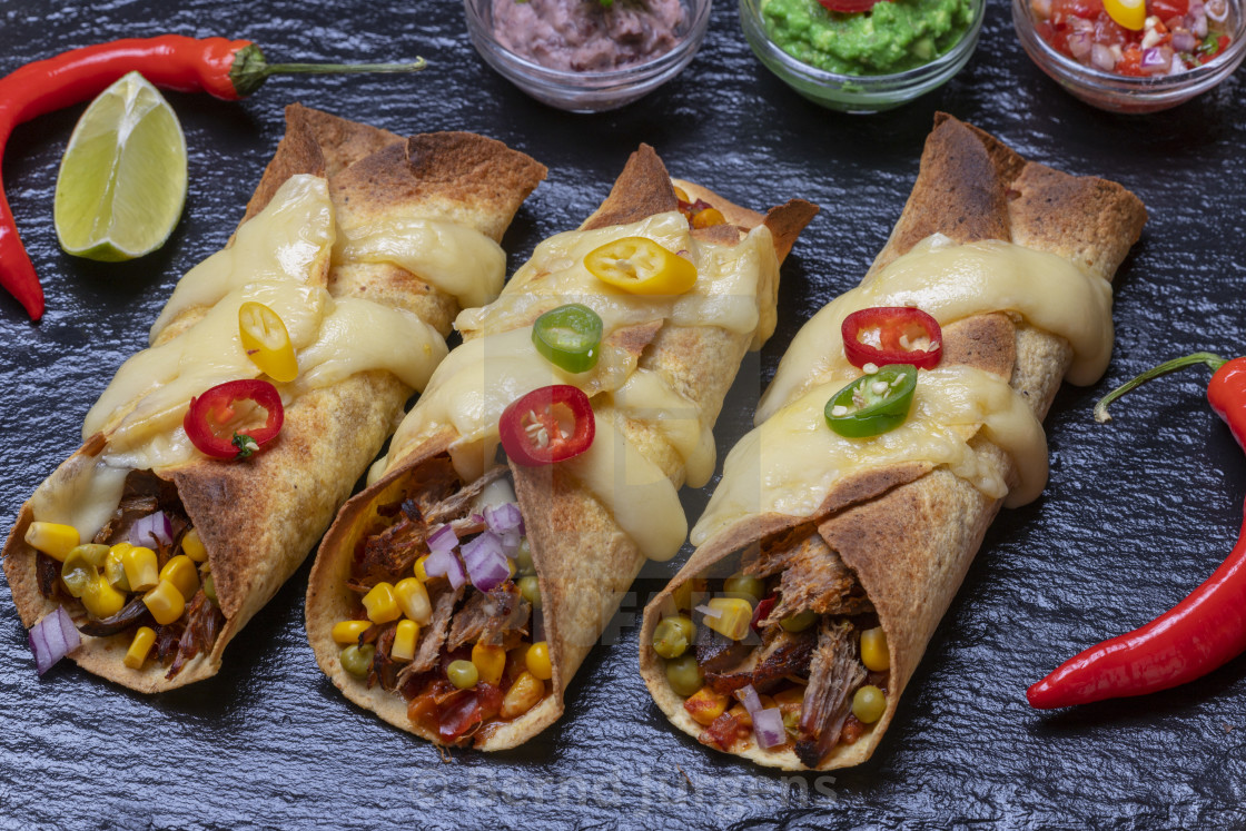 """""""overview of baked enchiladas with salsa"""" stock image"""