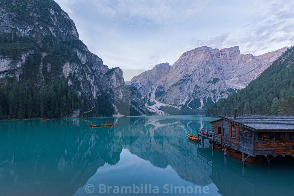 Mooring of boats on Lake Braies at first light in the morning