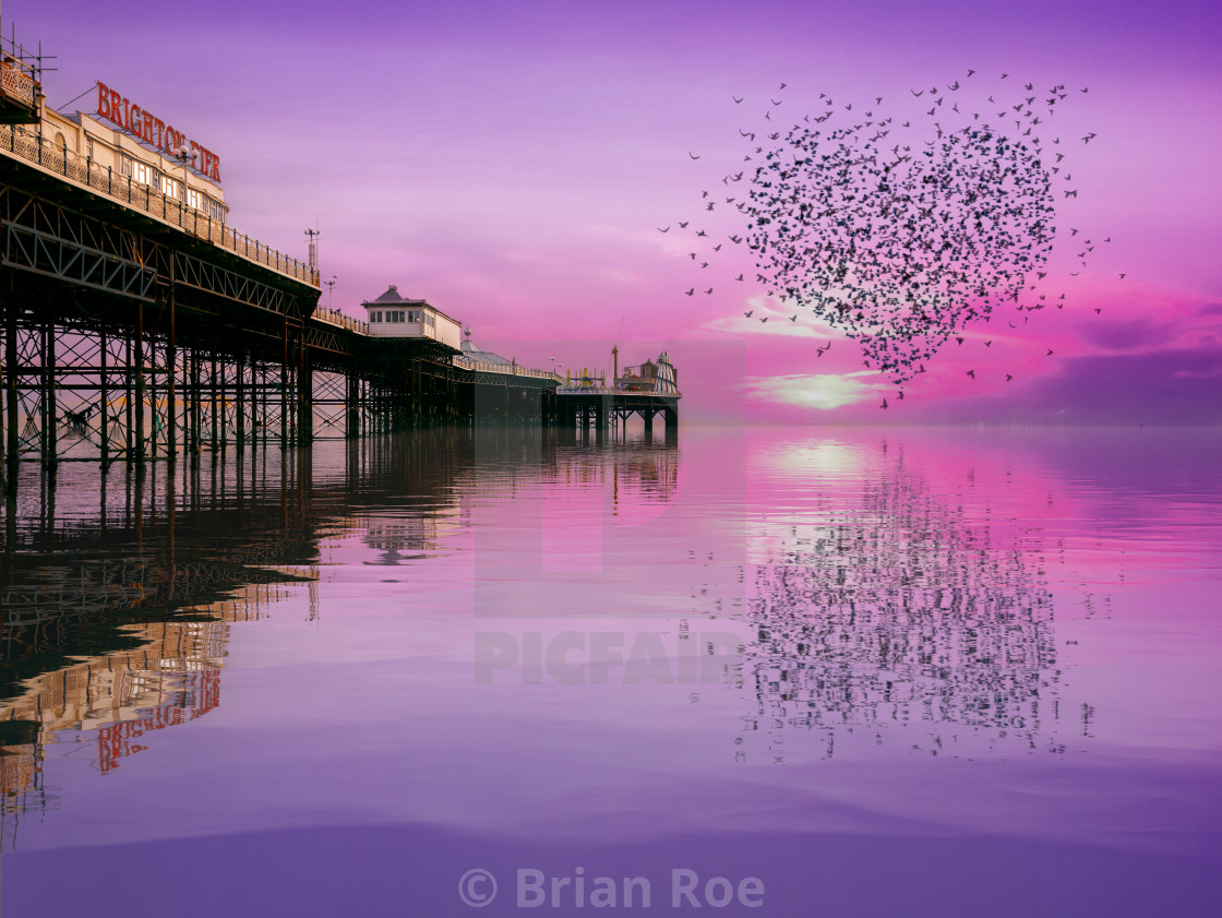 """""""Love Heart Murmurations over the Palace Pier, Brighton"""" stock image"""