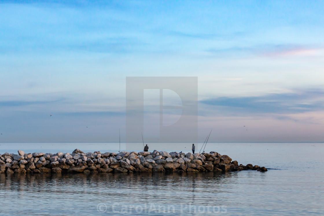 """Fishermen at sunset"" stock image"