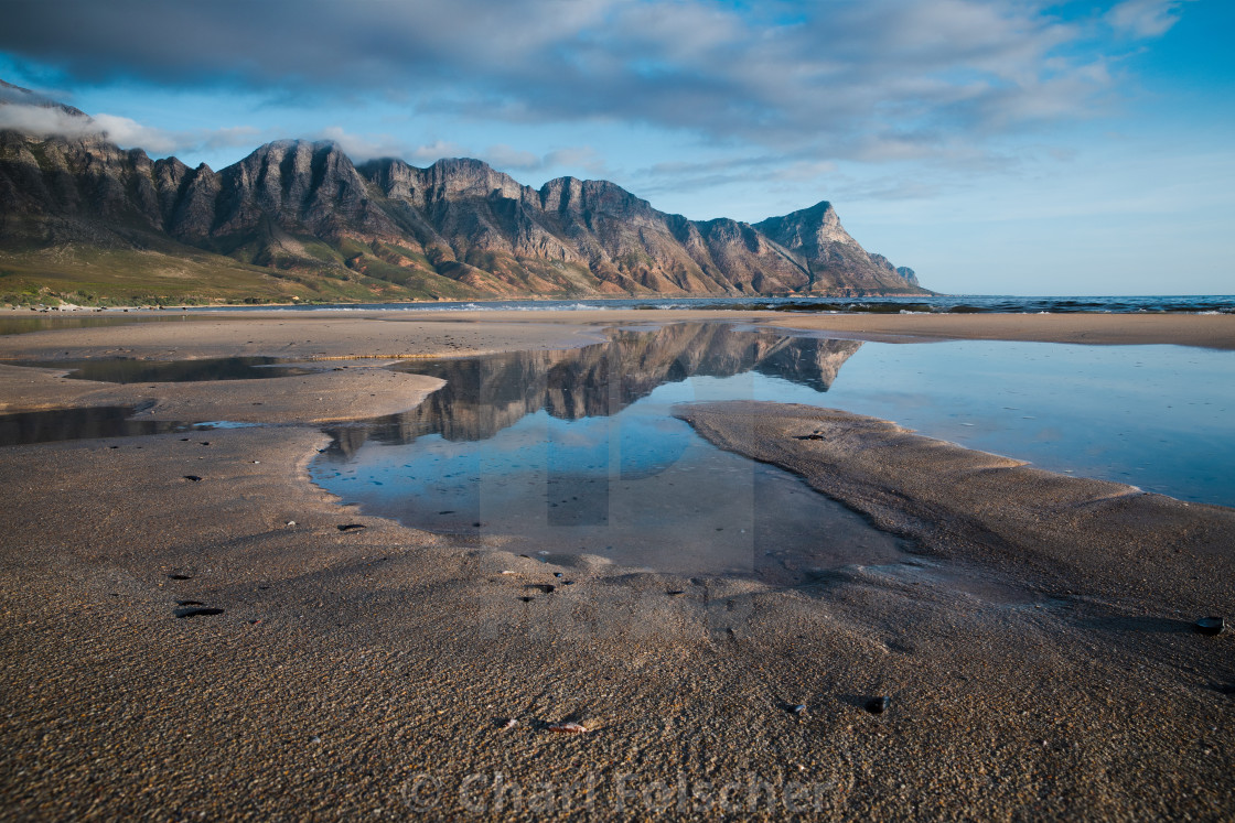 """""""Mountain reflection in beach pool"""" stock image"""