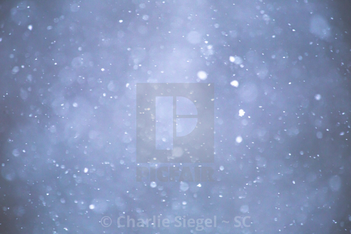 """Snowflakes Falling Through the Sky"" stock image"