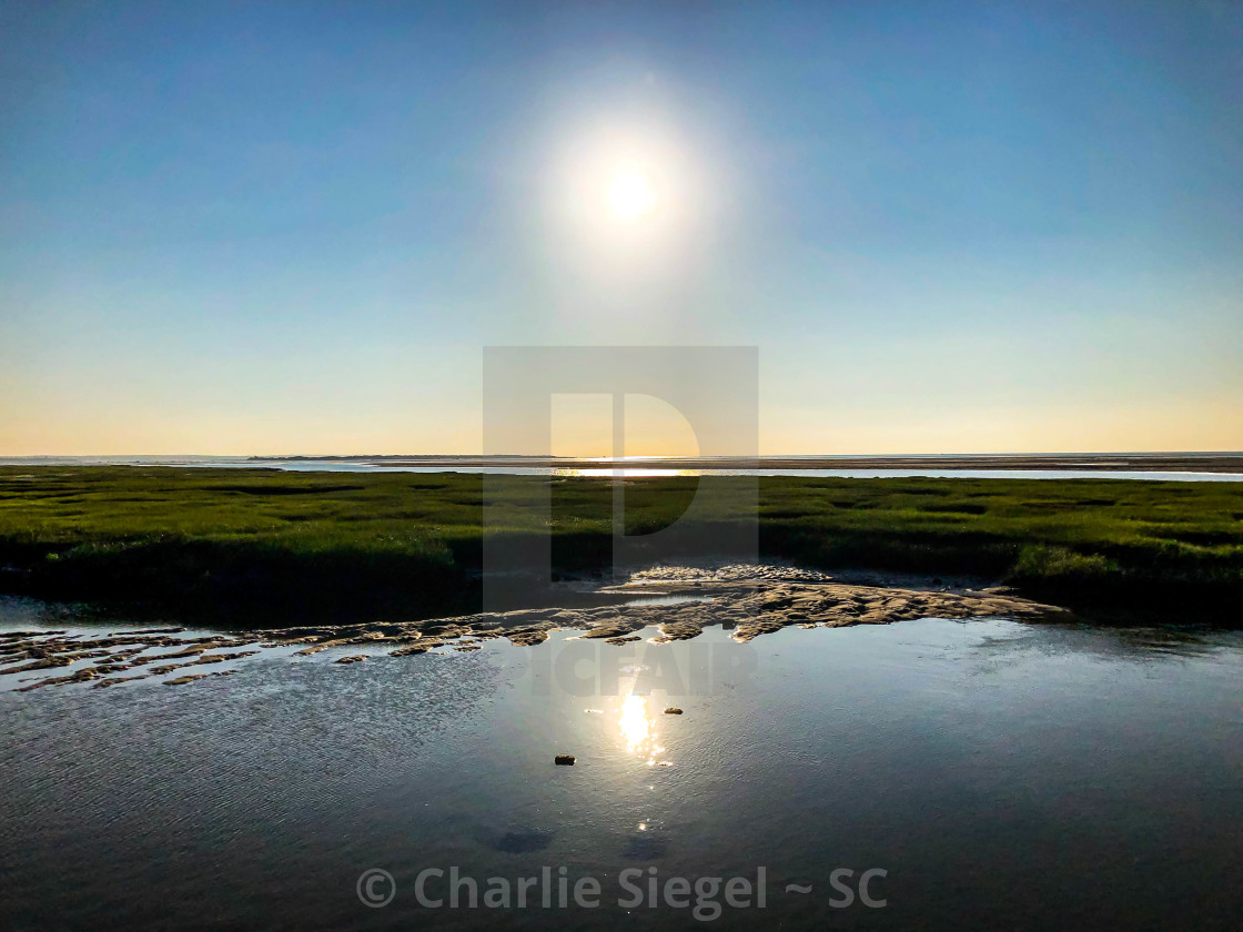 """Sun Reflected at Low Tide"" stock image"