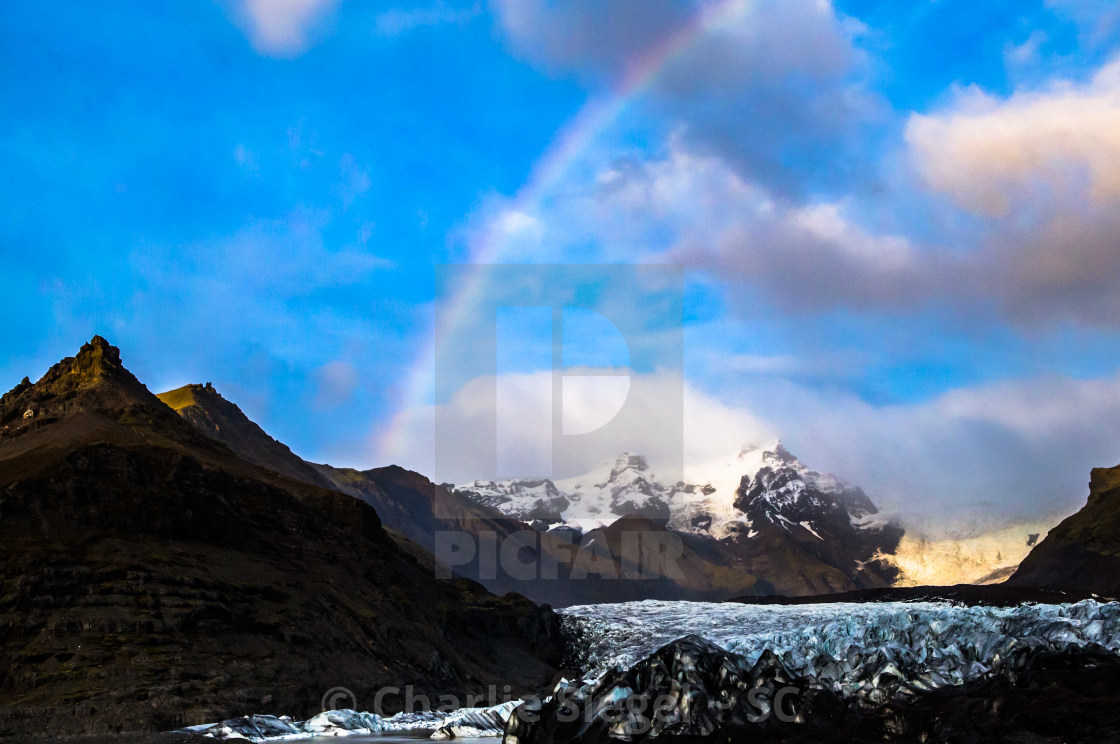 """Rainbow over a Glacial Landscape in Iceland"" stock image"