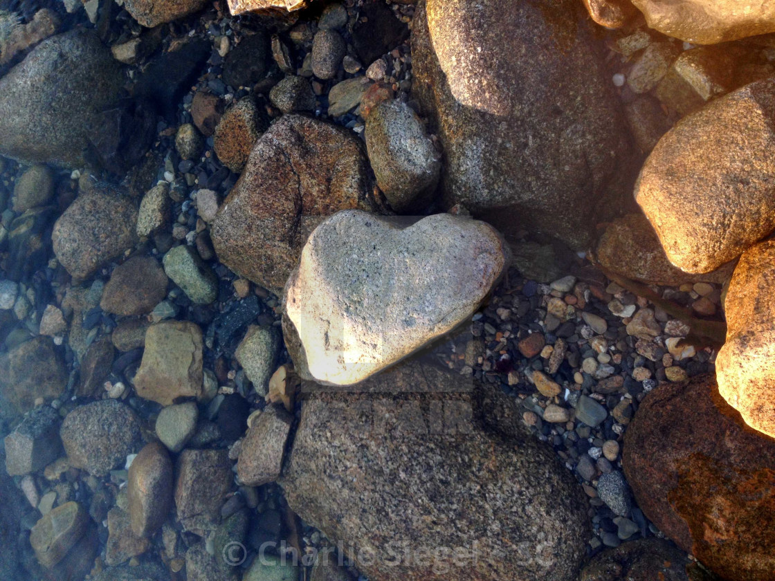 """Heart Shaped Rock on the Beach at Sunset"" stock image"