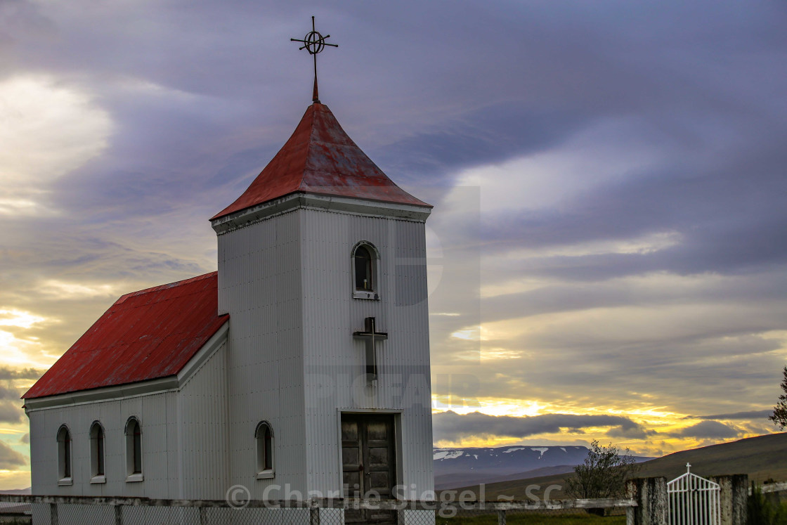 """Traditional Icelandic Church surrounded by Beautiful Sky"" stock image"