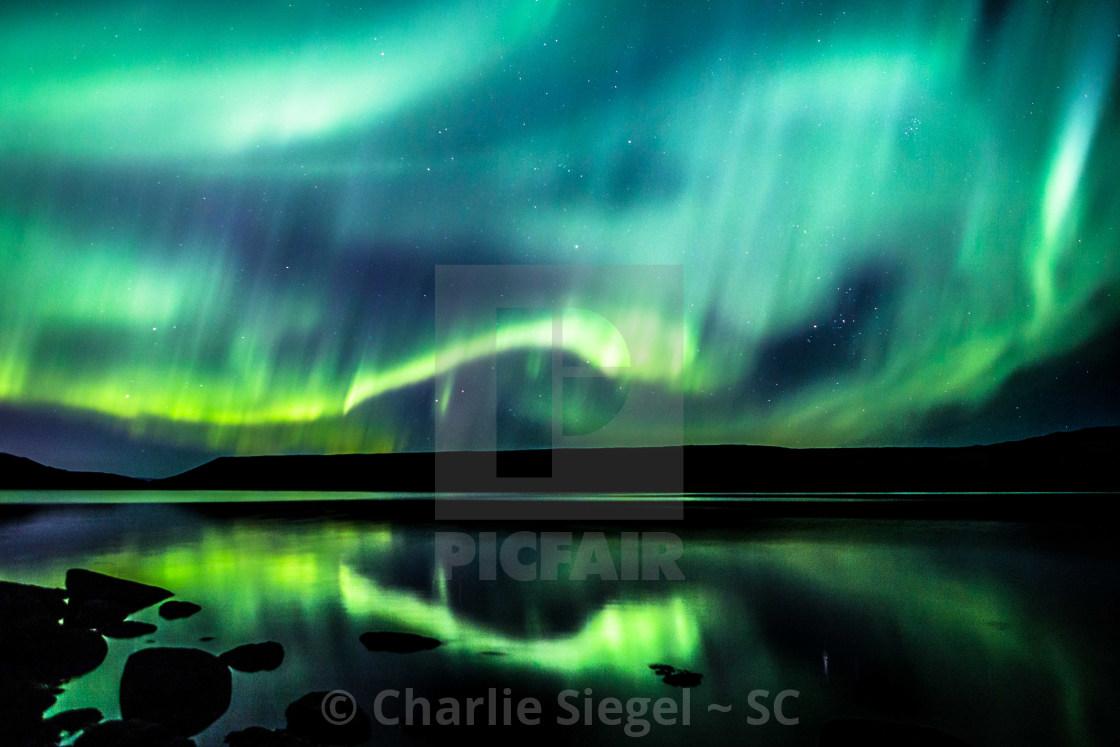 """Dragon of the Northern Lights over Iceland"" stock image"