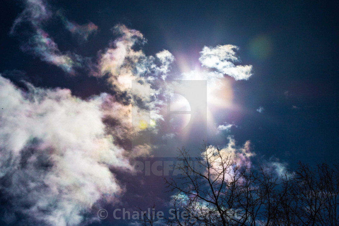 """""""Iridescent Clouds beside the Sun"""" stock image"""