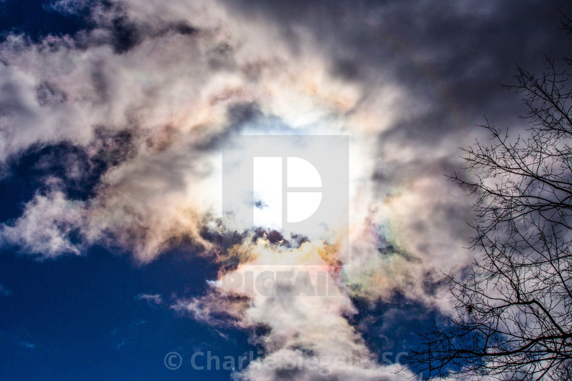 """""""Heart shape in iridescent clouds around the sun"""" stock image"""