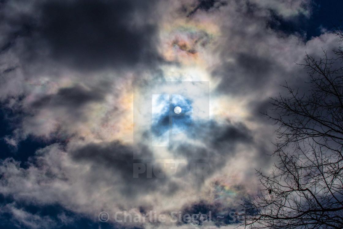 """Iridescent Clouds around the Sun"" stock image"