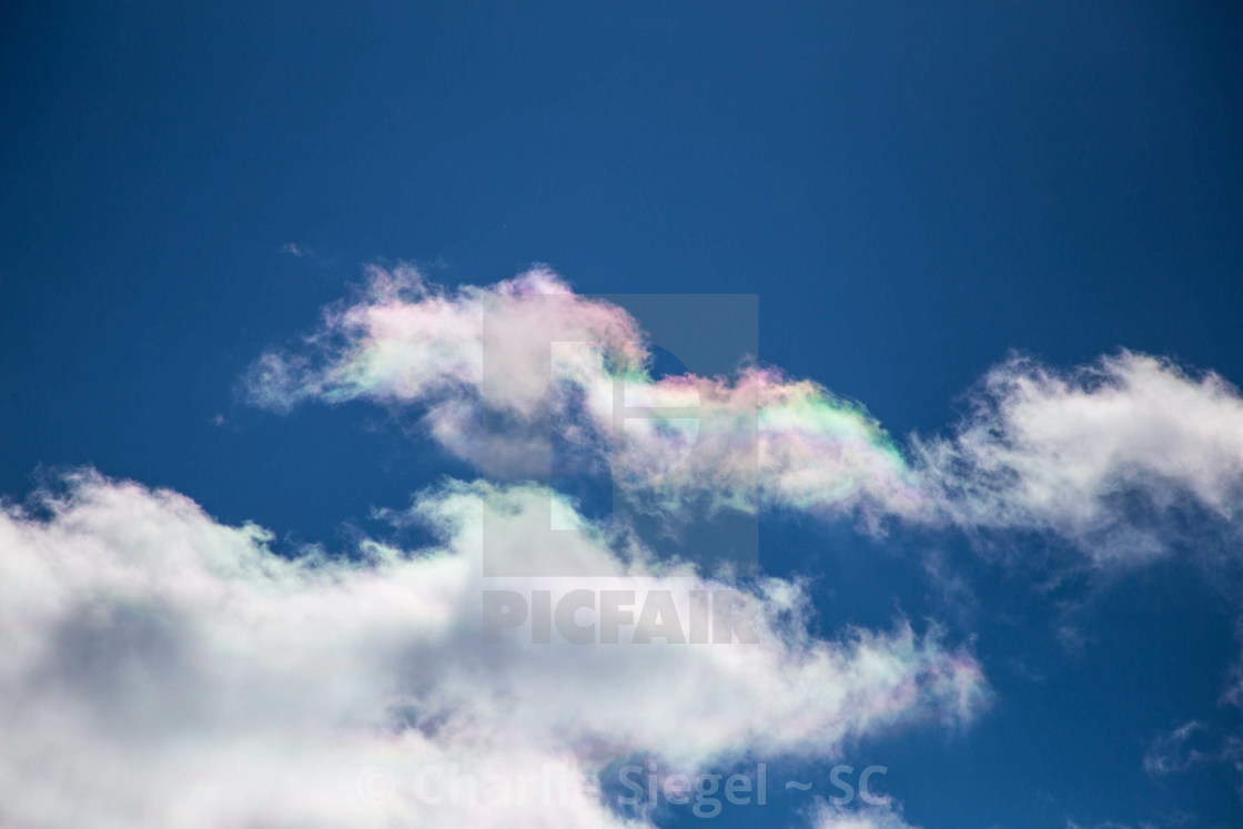 """Rare beautiful iridescent clouds in a blue sky"" stock image"