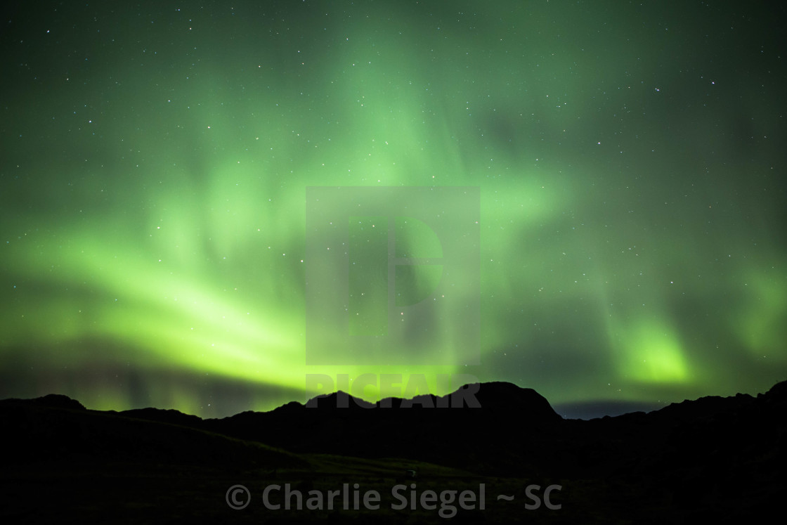 """""""Green Northern Lights over Hills of Iceland"""" stock image"""