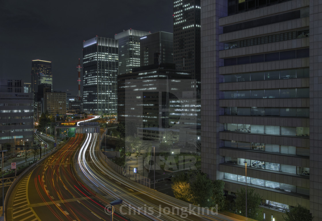 """""""Busy Expressway Curving through Dark Urban Cityscape"""" stock image"""