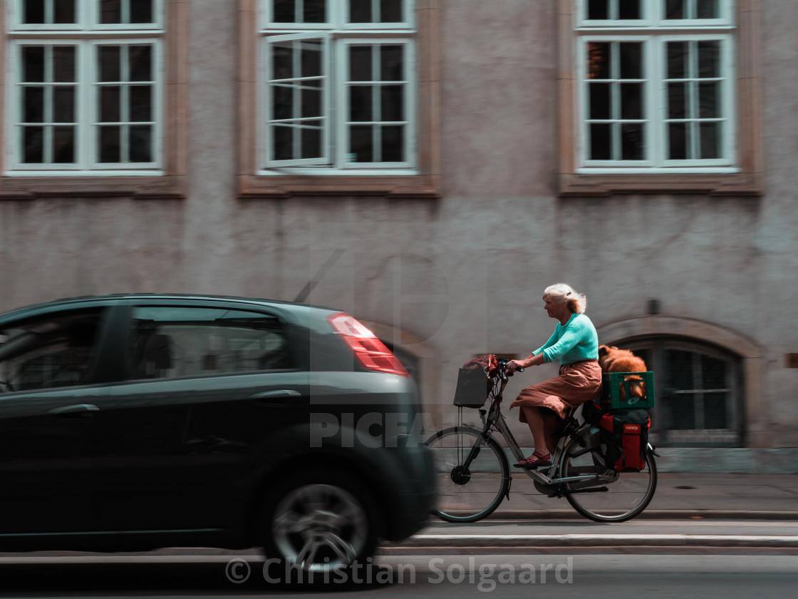 """Woman on bike"" stock image"
