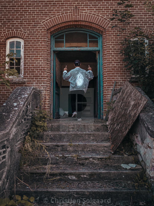 """""""Entering abandoned house"""" stock image"""