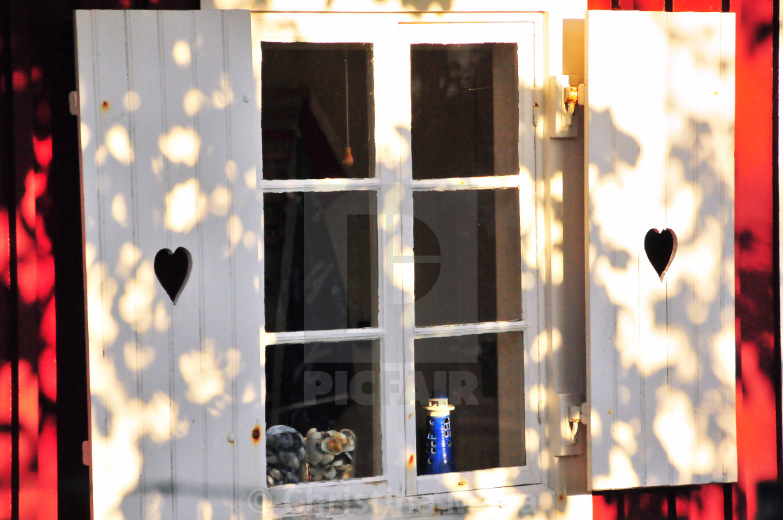 """""""Small lighthouse behind a Swedish window"""" stock image"""