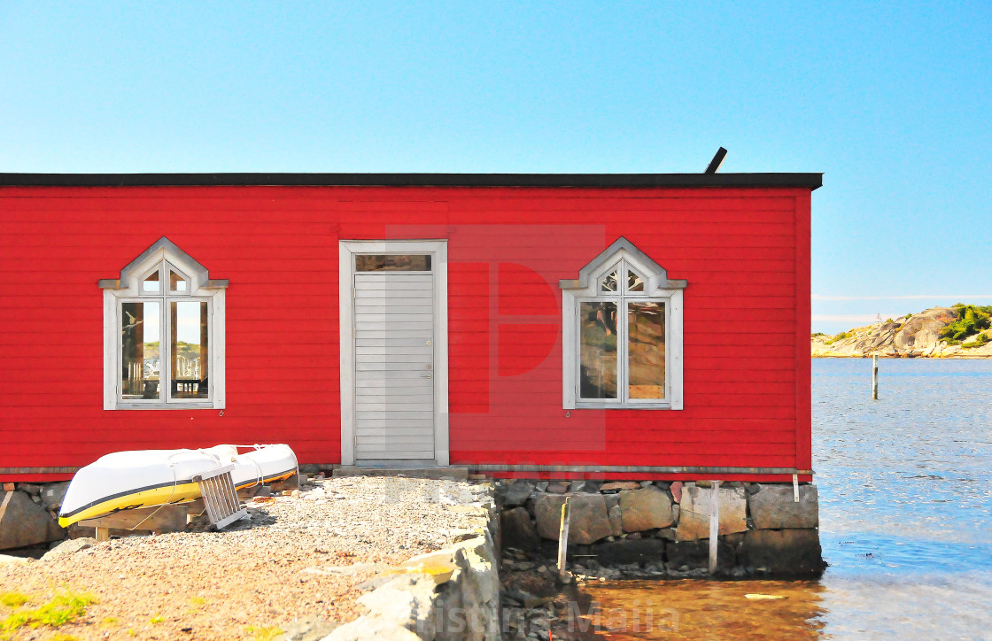 """""""Red painted bath and boat house near Gothenburg, Skagerak"""" stock image"""