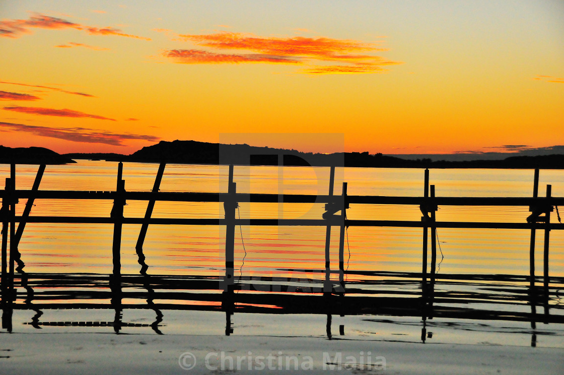 """""""A sunset kissed moment in one of the peaceful Skagerak bays"""" stock image"""