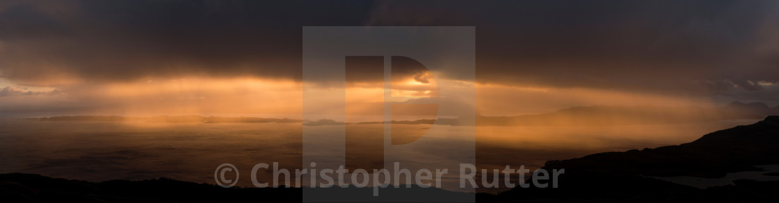 """Sun breaking through the clouds over Raasay"" stock image"