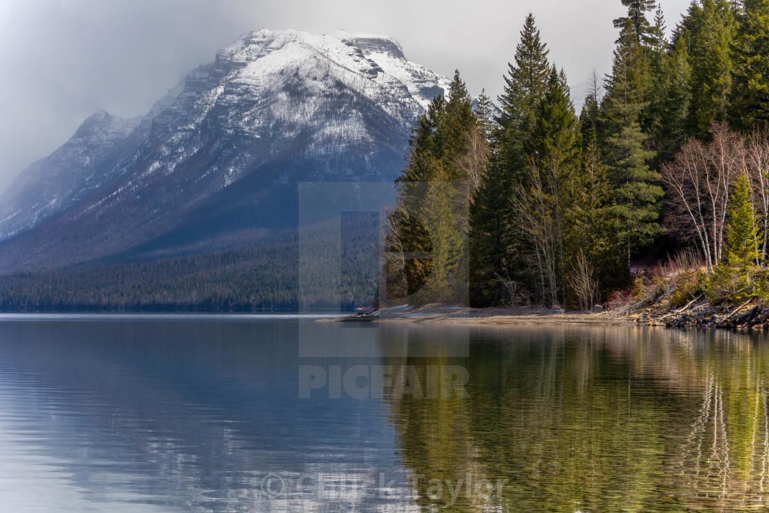 """vacation-lake mcdonald-glacier-national park-misty morning"" stock image"