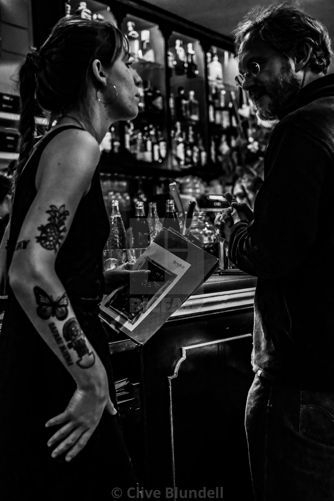 """Tapas waitress and customer"" stock image"