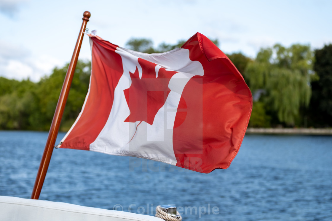 Canadian flag flies on boat's stern