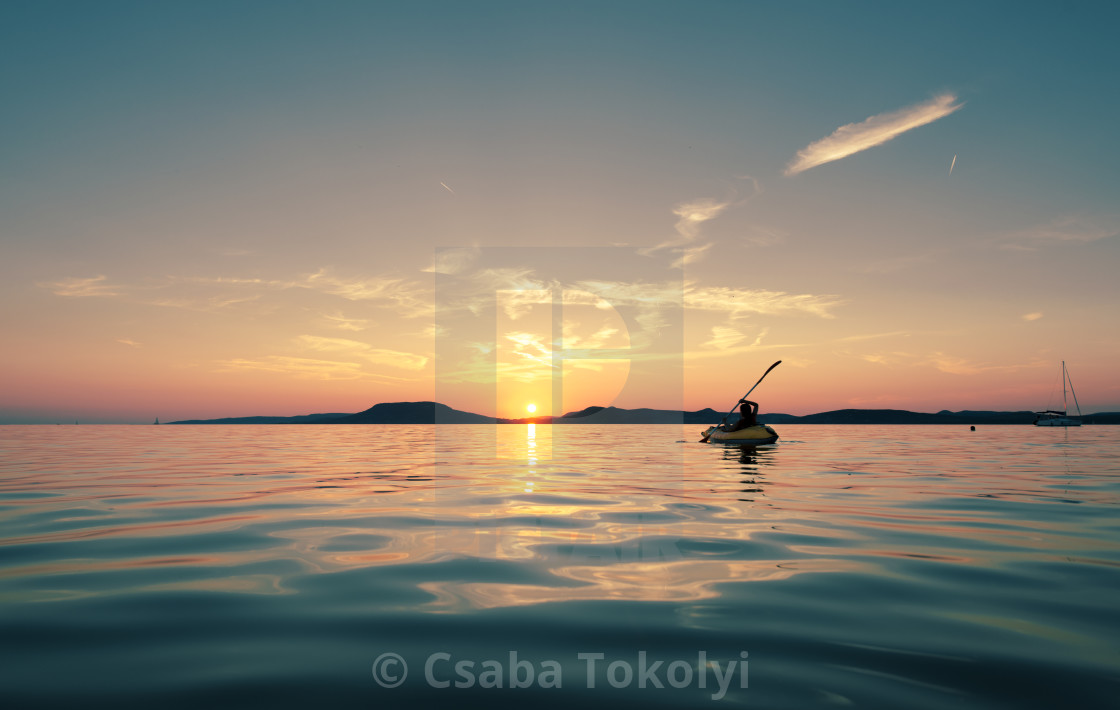 """Paddling into the sunset"" stock image"