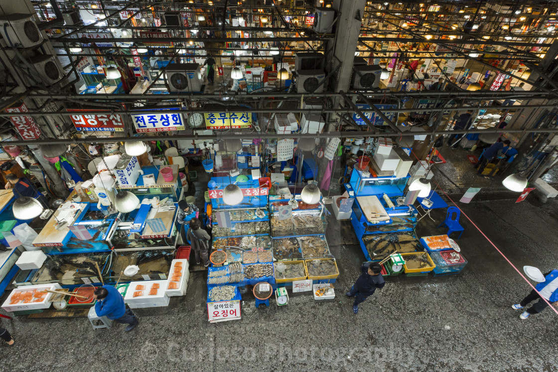 """SEOUL - OCTOBER 23, 2016: Aerial view of shoppers at Noryangjin Fisheries..."" stock image"