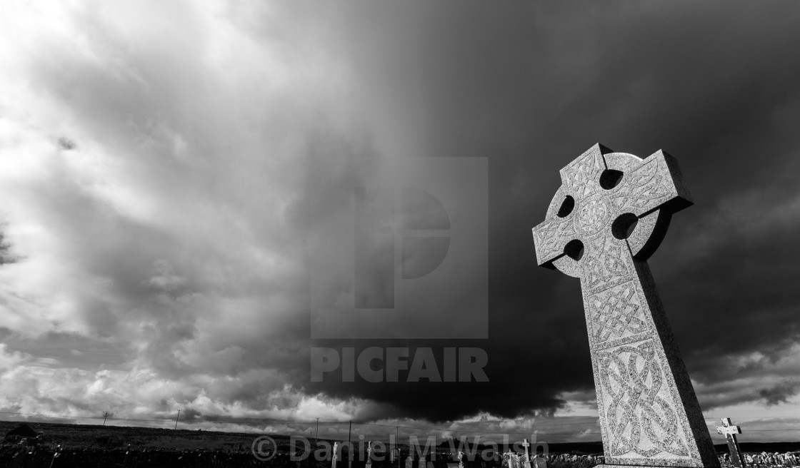 """Celtic Cross against a dramatic sky"" stock image"
