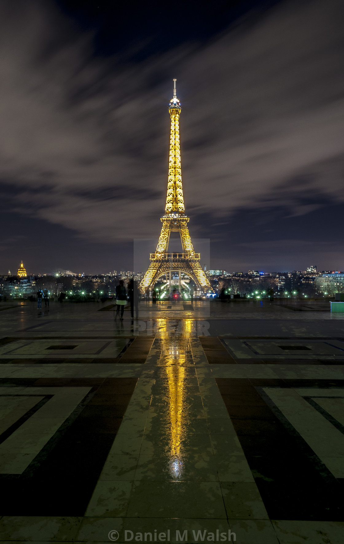 """Eiffel Tower at night with reflection in rainwater"" stock image"
