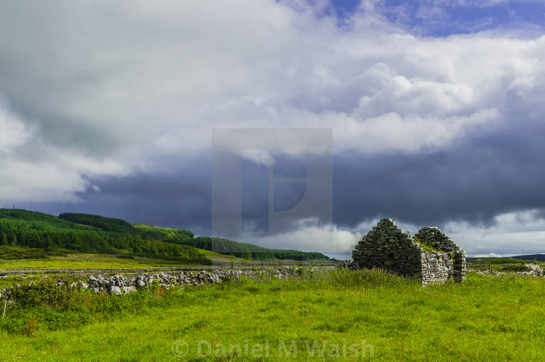 """Ruins of old Irish cottage with stone walls ."" stock image"