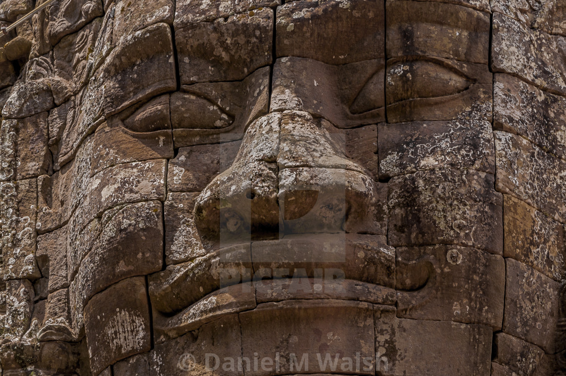 """Stone face carving on Temple Cambodia"" stock image"